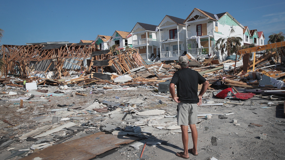 A resident of Mexico Beach, Fla., looks over damage caused to the Florida Panhandle by Hurricane Michael in October 2018. (Scott Olson/Getty Images)