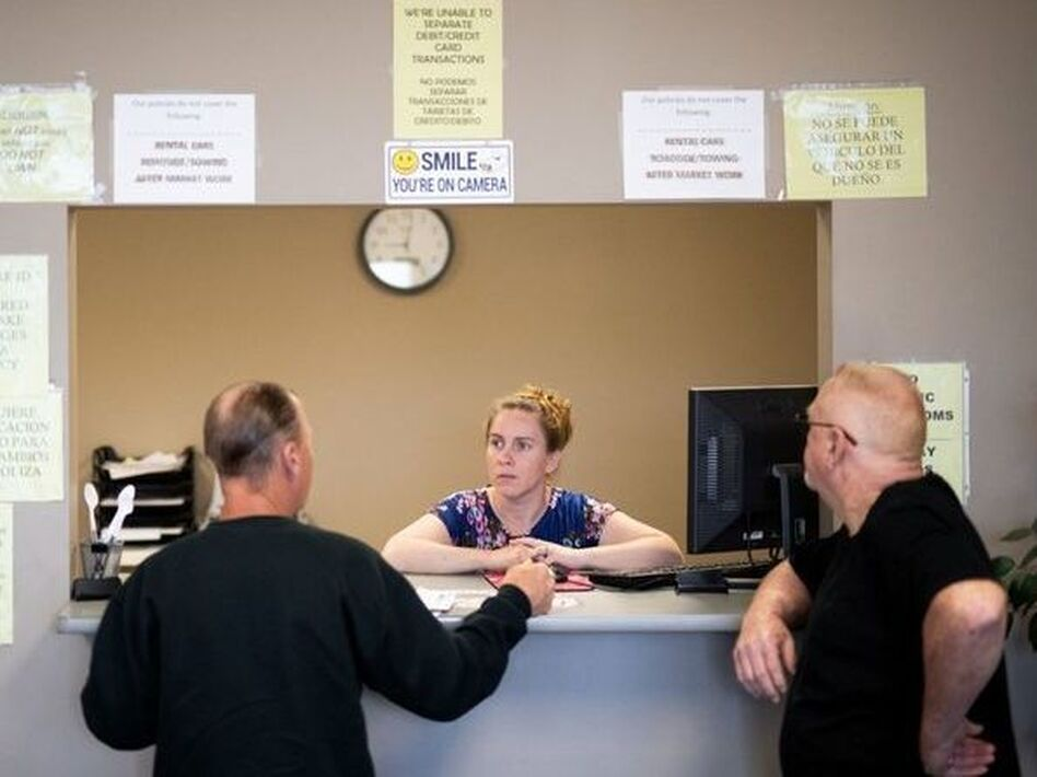 "Clarisa Corber at work at a Topeka, Kan., insurance agency. Corber and her husband — who have three kids, a health plan and $15,000 in medical debt — were profiled in a recent <em>Los Angeles Times</em> <a href=""https://www.latimes.com/politics/la-na-pol-health-insurance-medical-debt-20190502-story.html"">investigation into the effects of high-deductible health plans</a>. (Nick Krug/Los Angeles Times)"