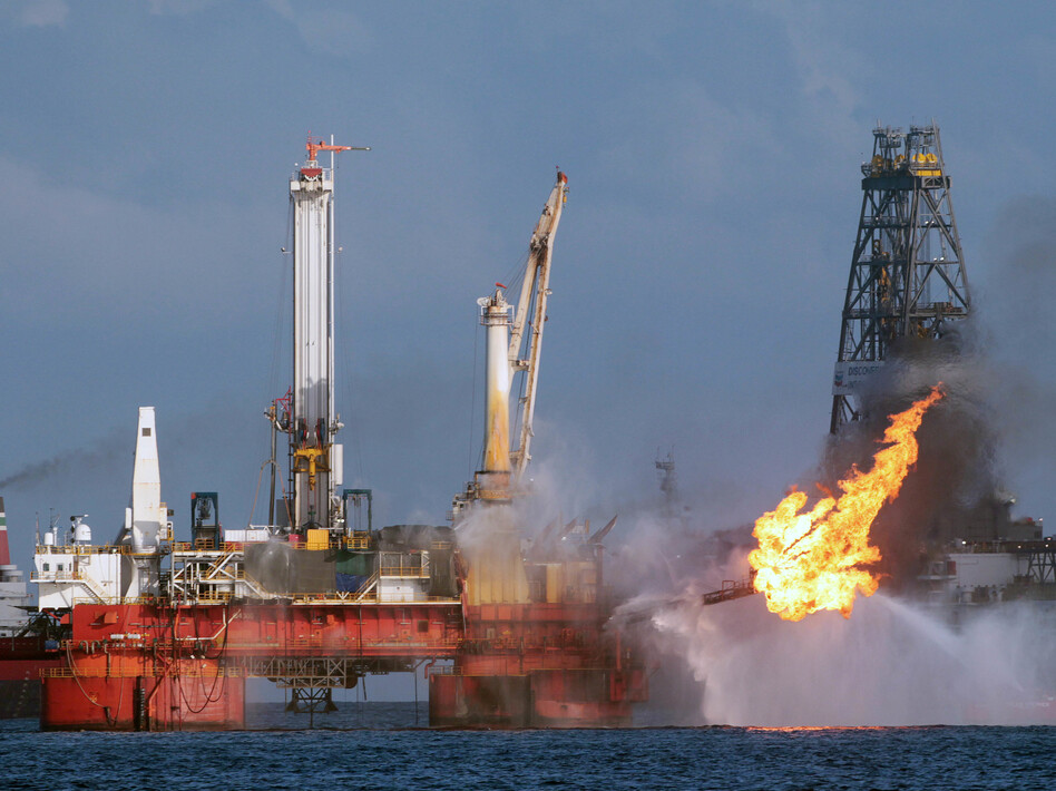 The area of the Deepwater Horizon oil rig is seen here in July 2010, shortly before the Macondo well was capped after spilling oil for 87 days. The Trump administration has proposed revisions to Obama-era rules that aimed to prevent similar disasters. (Dave Martin/Associated Press)