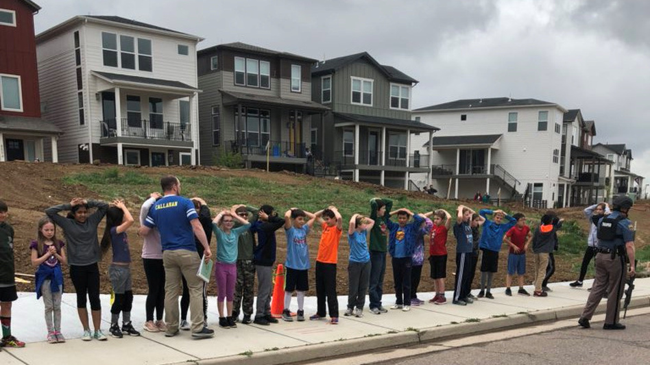 Students line up near STEM School Highlands Ranch during a shooting at the Colorado school that left one dead and eight injured on Tuesday. (Shreya Nallapati via Reuters)