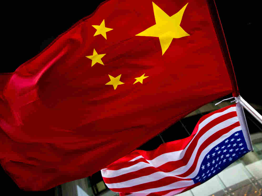 U.S. and Chinese flags hang outside a hotel during a U.S. presidential election event organized by the U.S. embassy in Beijing on Nov. 7, 2012.