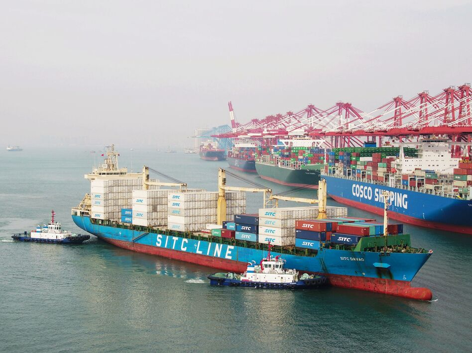 A cargo ship prepares to berth at a port in Qingdao in China's eastern Shandong province on Wednesday. New tariffs went into effect Friday. (AFP/Getty Images)