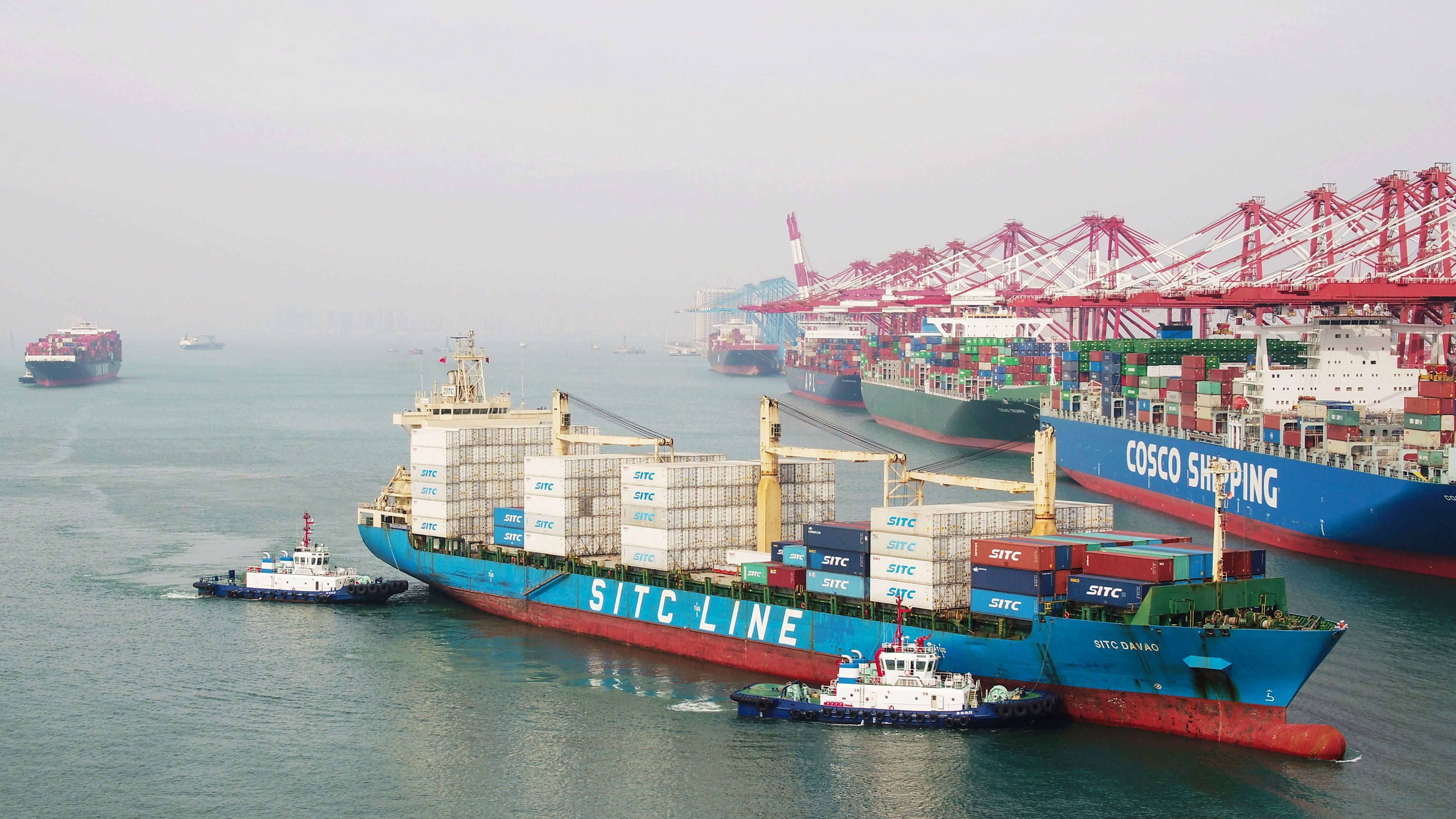 A cargo ship prepares to berth at a port in Qingdao in China's eastern Shandong province on Wednesday. New tariffs went into effect Friday.