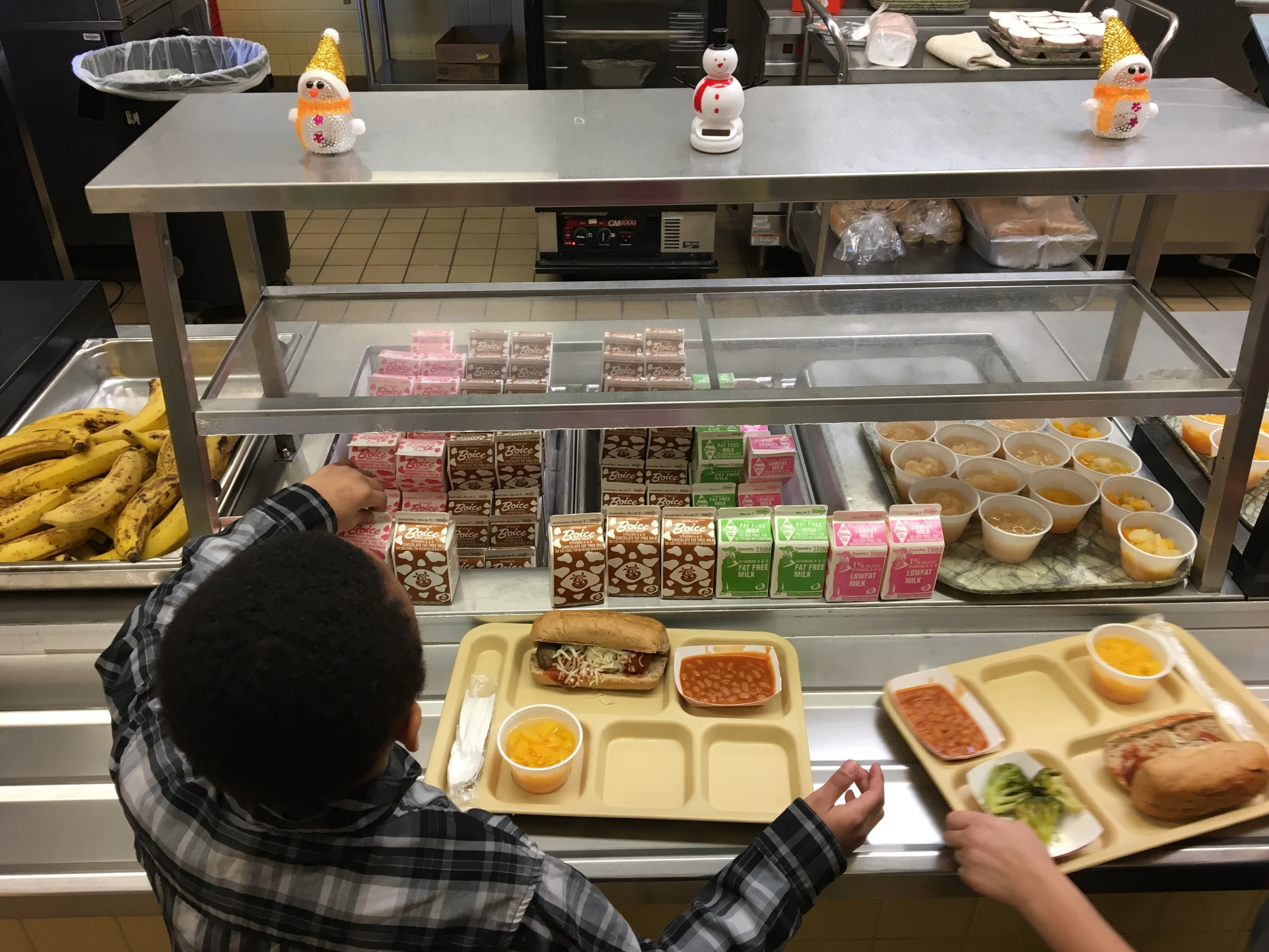 Students in New York fill their lunch trays with hot food. In Rhode Island, a controversy over a plan to limit children to cold sandwiches if they had outstanding lunch balances was quickly reversed this week.