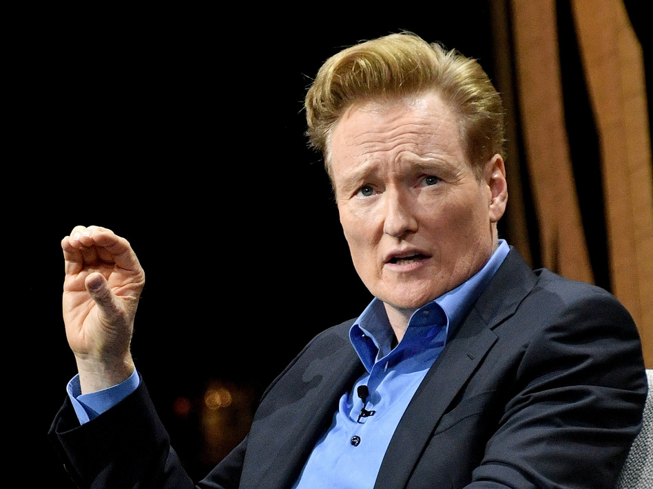Late night TV host Conan O'Brien, pictured in 2016, has settled a lawsuit with a man who accused O'Brien and his writing staff of stealing his jokes. (Mike Windle/Getty Images for Vanity Fair)