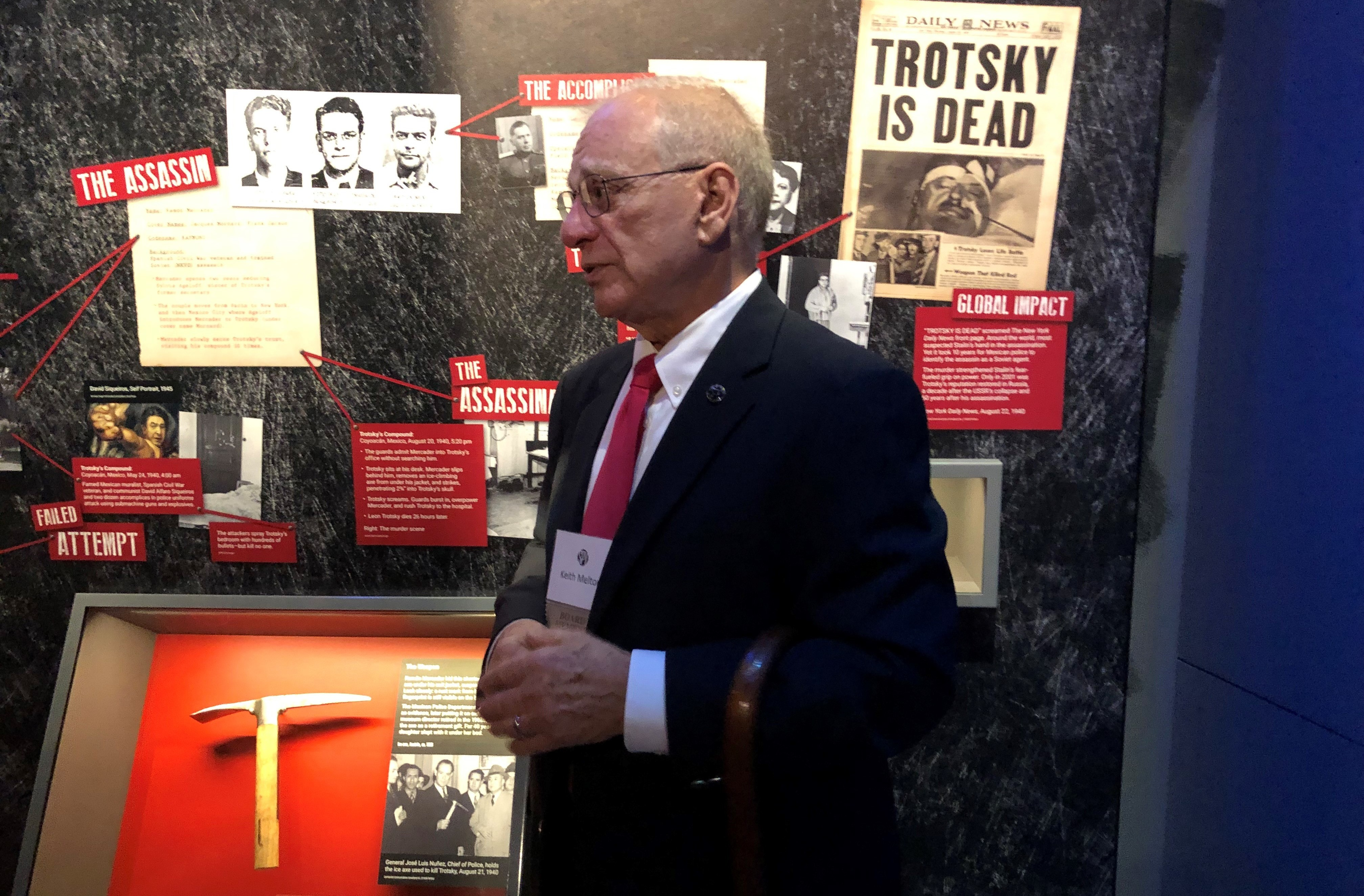 H. Keith Melton, a longtime collector of spy artifacts, stands next to the axe that was used to kill Soviet exile Leon Trotsky in Mexico in 1940. The axe is part of Melton's huge collection that he's donated to the new International Spy Museum.