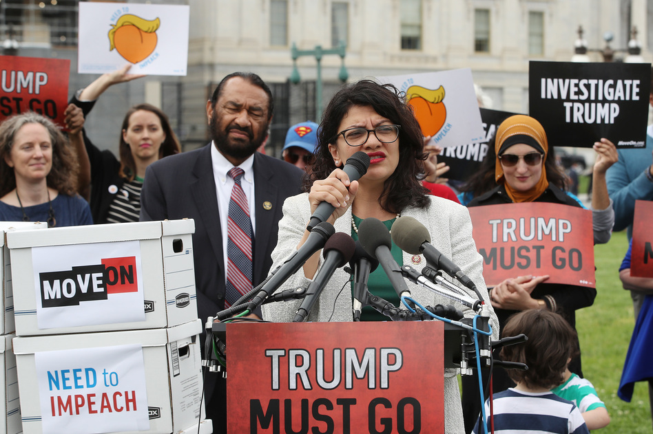 Rep. Rashida Tlaib, D-Mich., speaks to activists gathered Thursday in Washington, D.C., to deliver more than 10 million petition signatures to Congress urging the House to start impeachment proceedings against President Trump. (Mark Wilson/Getty Images)