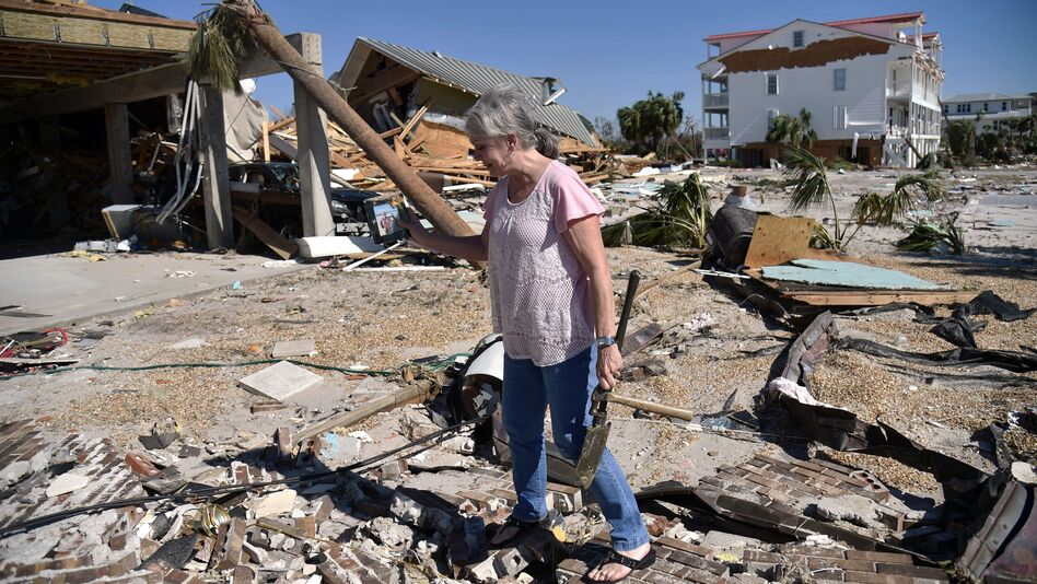 In the aftermath of Hurricane Michael last year, a woman tries to recover belongings from the place where her house once stood in Mexico Beach, Florida. (Hector Retamal/AFP/Getty Images)