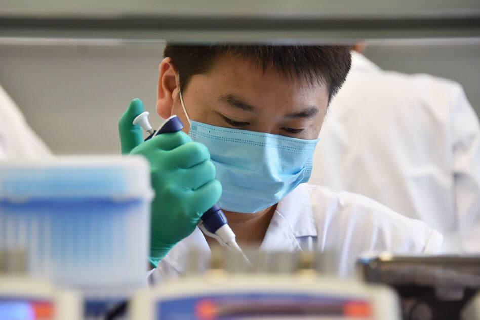 "A technician works in a lab at GeseDNA Technology in Beijing. To counter China, the U.S. plans to impose new export restrictions on ""emerging and foundational technology"" that researchers say could affect the way they share genetic materials with international labs. (Greg Baker/AFP/Getty Images)"