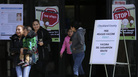 Signs advertising free measles vaccines and providing information about measles are displayed at the Rockland County Health Department in Pomona, N.Y. The county in New York City's northern suburbs has had more than 200 measles cases since last fall.