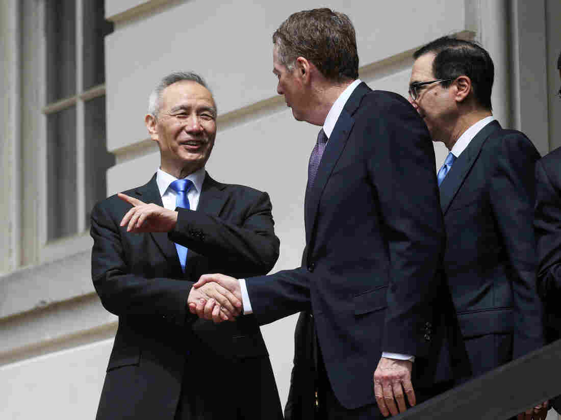 China says will 'never surrender' as USA  trade row heats up
