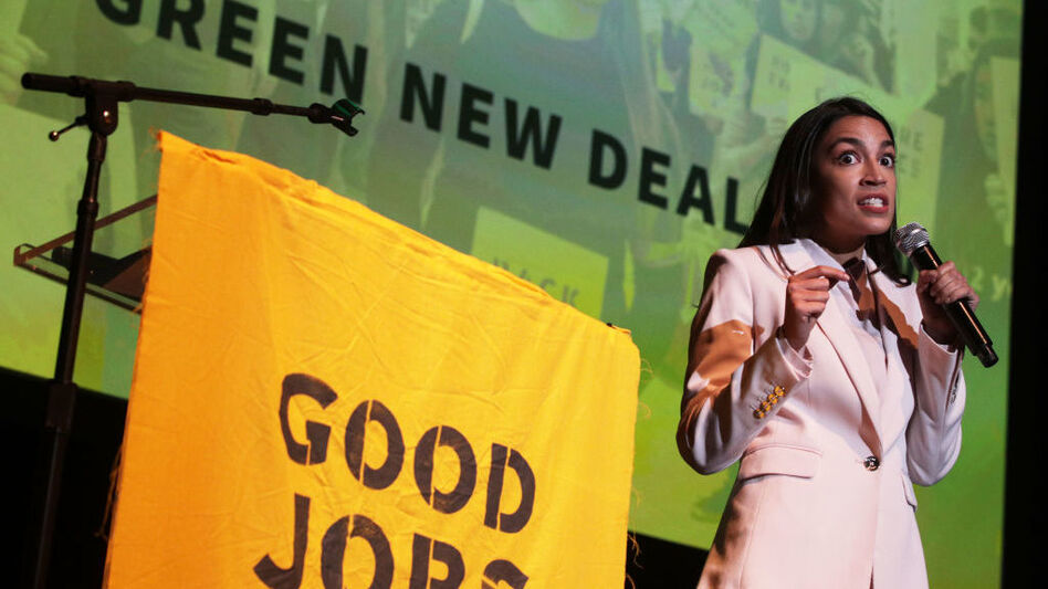 "Rep. Alexandria Ocasio-Cortez, D-N.Y., speaks during a rally at Howard University on Monday. The Sunrise Movement held an event for the final stop of the ""Road to a Green New Deal"" tour to ""explore what the pain of the climate crisis looks like in D.C. and for the country and what the promise of the Green New Deal means."" (Alex Wong/Getty Images)"