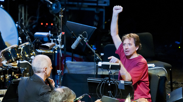"""John Zorn, in red, conducts music from """"Book of Angels"""" with the Bar Kokhba Sextet (featuring Marc Ribot on guitar, Mark Feldman on violin, Erik Friedlander on cello and Cyro Baptista on percussion) during his """"Masada Marathon"""" at Lincoln Center in New York on March 30, 2011."""