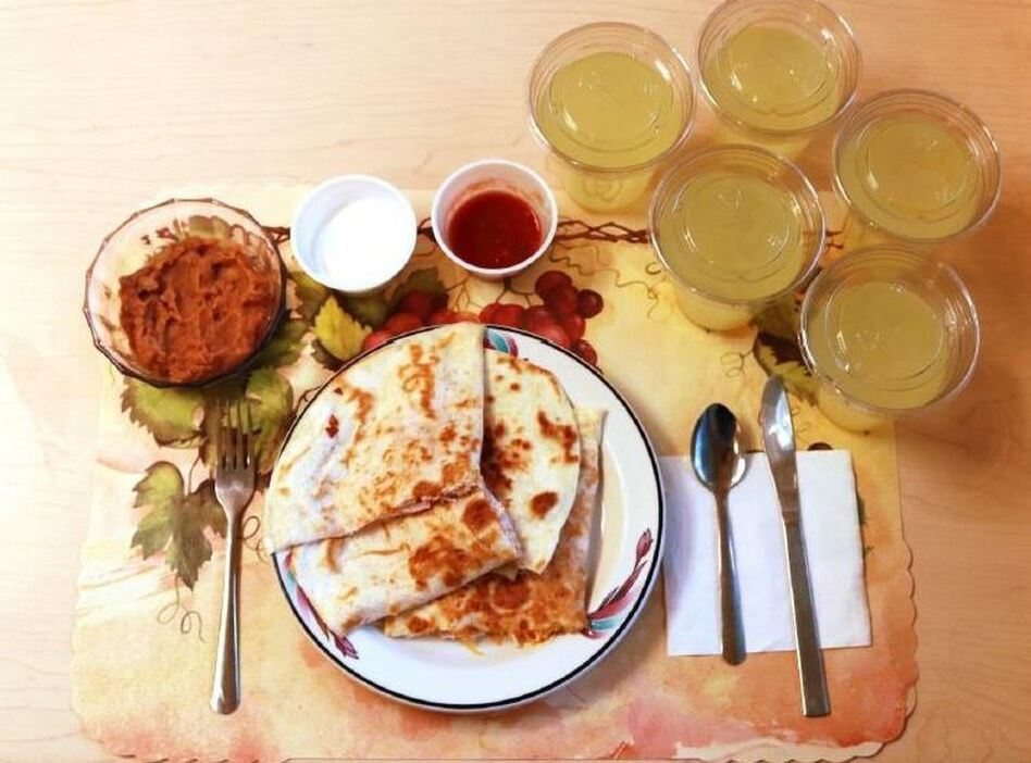 An example of one of the study's ultra-processed lunches consists of quesadillas, refried beans and diet lemonade. Participants on this diet ate an average of 508 calories more per day and gained an average of 2 pounds over two weeks. (Hall et al./Cell Metabolism)