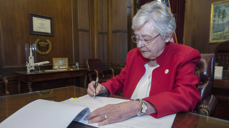 On Wednesday, Alabama Gov. Kay Ivey signed into law a ban on nearly all abortions. (Hal Yeager/Alabama Governor's Office via AP)