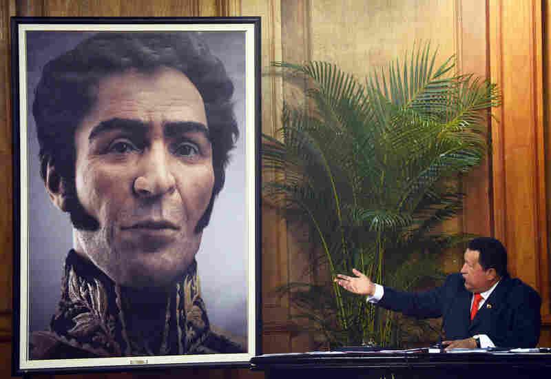 Former Venezuelan President Hugo Chavez shows a digital rendering of Simon Bolivar from genetic data on Bolivar's birthday on July 24, 2012. Chavez had Bolivar's remains exhumed in 2010.