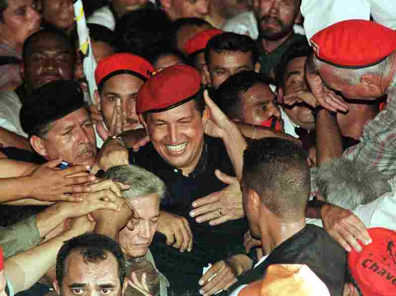 Venezuelan presidential candidate Hugo Chavez is greeted by supporters as he arrives at his campaign closing rally in Caracas in December, 1998. Some 400,000 people reportedly attended the rally. Chavez would go on to win four presidential terms in total.
