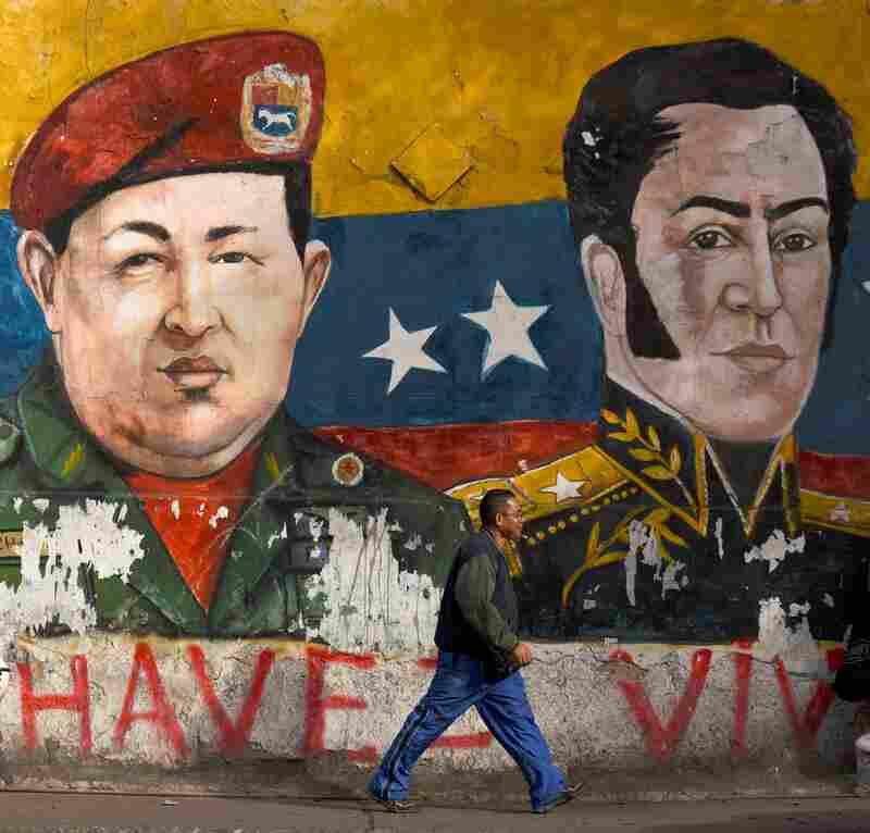 Graffiti depicting late Venezuelan president Hugo Chavez and revolutionary leader Simon Bolivar.