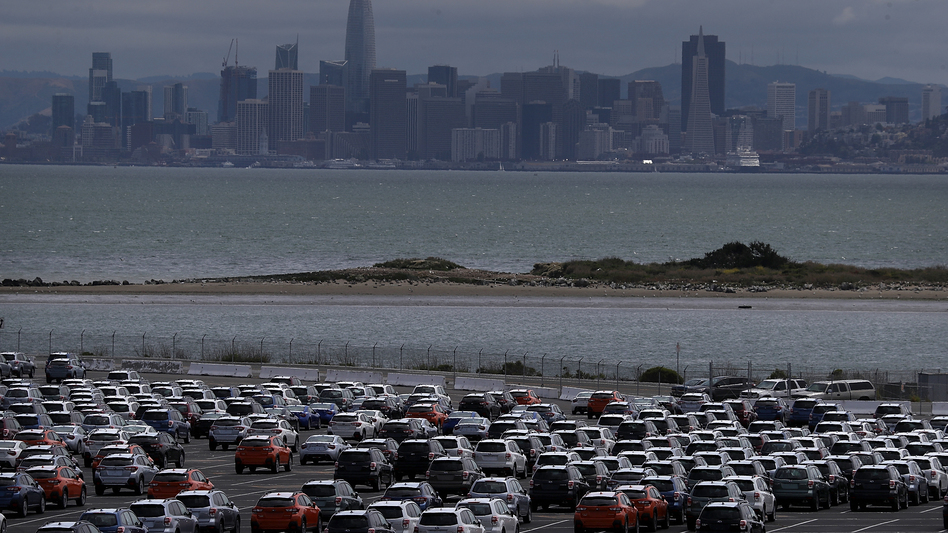 New cars sit in a lot at the Auto Warehousing Co. near the Port of Richmond in Caliornia last year. President Trump has threatened to impose heavy tariffs on auto imports, but the White House has not announced a decision. (Justin Sullivan/Getty Images)