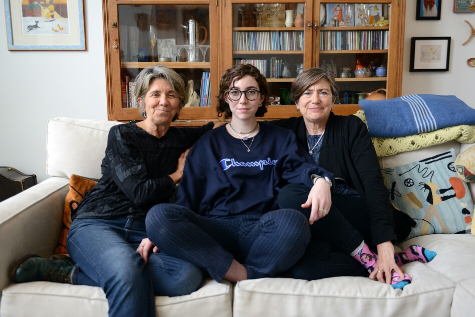 "Hillary and Julie Goodridge with their daughter, Annie (center). ""It was a lot of stress for all of us, all the time,"" says Annie, now 23, of her parents' involvement in the lawsuit that made same-sex marriages legal. ""When you have to be on all the time, it's hard to turn yourself off.""<strong></strong> (Meredith Nierman/WGBH)"