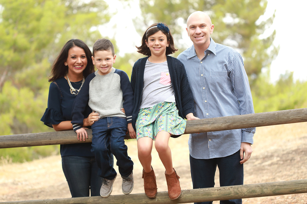 """Gaby Gemetti decided to leave the workforce after having her second child. In March she started a """"returnship,"""" a new type of program to recruit and retrain women like her who are looking to resume their careers. Here, Gaby and John Gemetti are seen with their children, Carlo and Gianna. (Courtesy of Shannon Wight Photography)"""