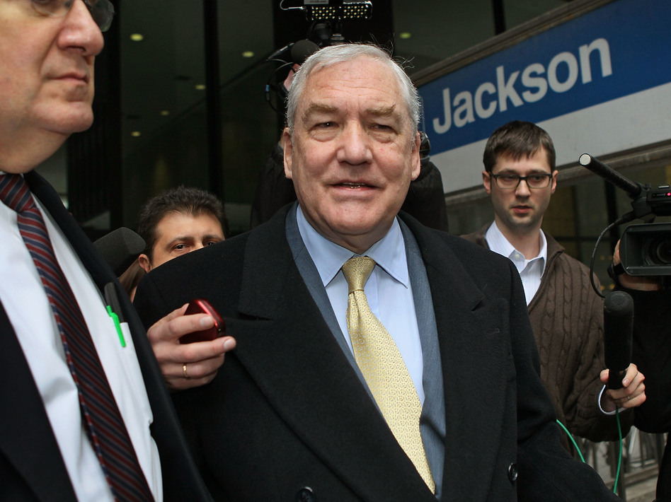 Former media baron Conrad Black was pardoned by President Trump on Wednesday. Black (center) is seen here following a 2011 hearing in Chicago. (Scott Olson/Getty Images)