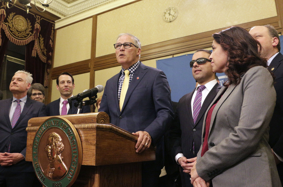 Washington Gov. Jay Inslee recently signed legislation making Washington the first state to enter the private health insurance market with a universally available public option. (Rachel La Corte/AP)