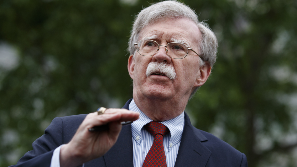 National security adviser John Bolton talked to reporters outside the White House. The hawkish former U.N. ambassador is stepping down. (Evan Vucci/AP)