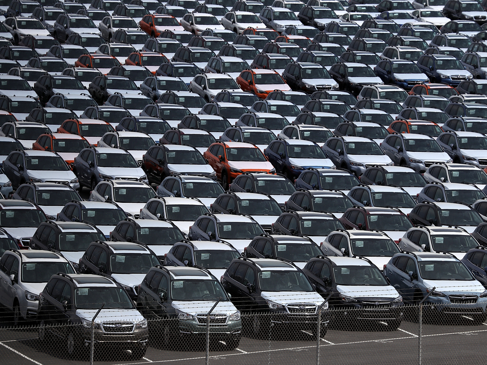 New cars sit in a lot at the Port of Richmond in California last year. The Trump administration on Friday announced a six-month delay in setting new tariffs on auto imports. (Justin Sullivan/Getty Images)