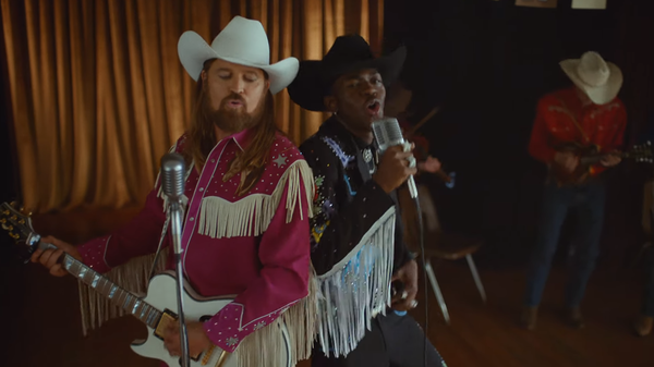 "Billy Ray Cyrus (left) and Lil Nas X star in the ""Old Town Road"" music video."