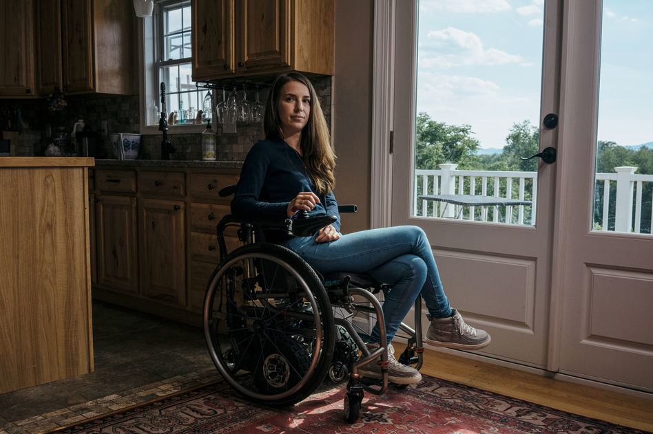 Dani Izzie at her home in rural Virginia. More than a decade ago, she slipped in the bathroom and suffered a spinal cord injury that has left her unable to walk. She works as a social media manager for Spinergy, a company that makes high-performance wheels for wheelchairs. (Greg Kahn for NPR)