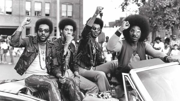 Members of the Nat Turner Rebellion ride in a parade during a Harambe Festival in Springfield, Mass., in the early 1970s. Pictured from left: Major Harris, Ron Hopper, Bill Stratley and Joe Jefferson.