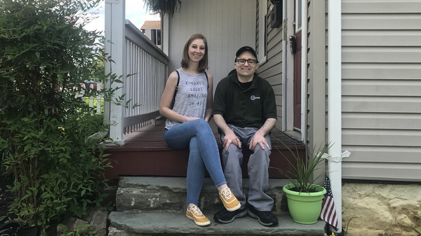 Ashley Merson and her brother Kevin sit on the porch of the house Ashley is trying to buy in the Hampden neighborhood of Baltimore. A ransomware attack on the city