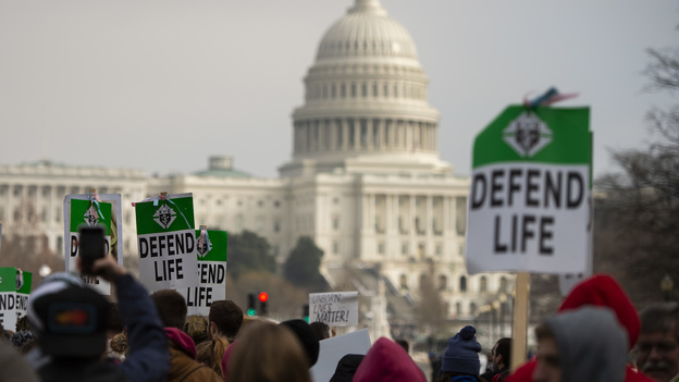 """Students and activists carry signs during the annual """"March for Life"""" in Washington, D.C., earlier this year. (Andrew Caballero-Reynolds/AFP/Getty Images)"""