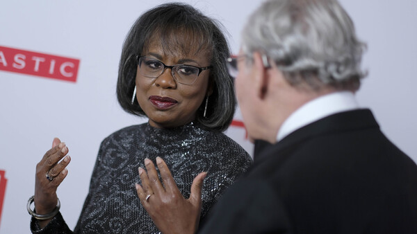 Anita Hill speaks with journalist Bob Woodward before the 2019 PEN America Literary Gala in New York City, where they were both recognized with awards Tuesday.