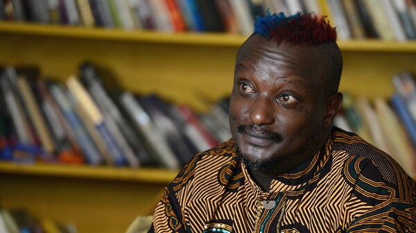 Kenyan author Binyavanga Wainaina, seen here during a January 2014 interview in Nairobi, has died at the age of 48. A founder of the Nairobi-based literary network Kwani?, Wainaina had come out as gay in a country where homosexuality was illegal.