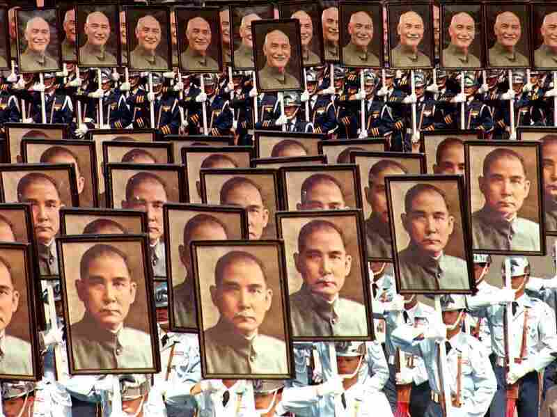 Military cadets carry portaits of Sun Yat-sen, the founding father of the Republic of China, and Chiang Kai-shek, the former president of Taiwan, during a march to mark the country's 82th National Day, 10 October 2001.