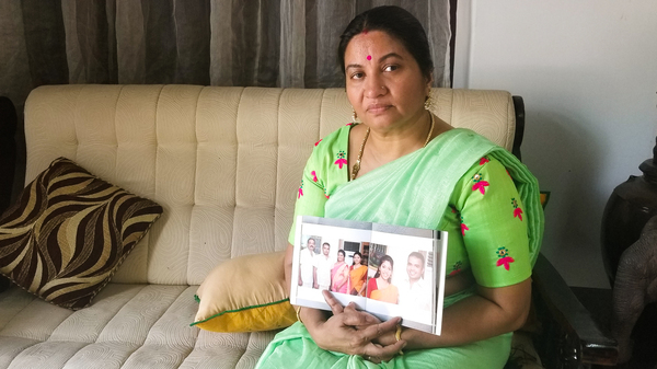 Bindu Sampath, 52, shows photos of her daughter Nimisha Sampath, now 29, who left India three years ago, after converting to Islam. She and her husband, a fellow Muslim convert, are wanted by Indian authorities for allegedly joining ISIS. They