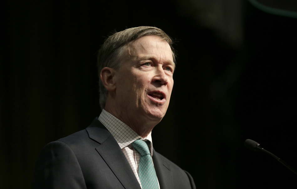"Democratic presidential candidate and former Colorado Gov. John Hickenlooper says Democrats need to focus on ""kitchen table issues"" like jobs in order to beat President Trump in 2020. (Seth Wenig/AP)"