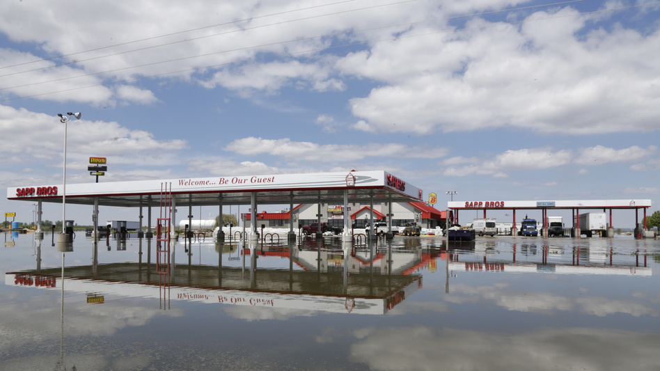 A Sapp Bros. gas station in Percival, Iowa, stands in floodwaters from the Missouri River on May 10. Lawmakers have reached a deal on disaster aid that they say President Trump will sign. (Nati Harnik/AP)