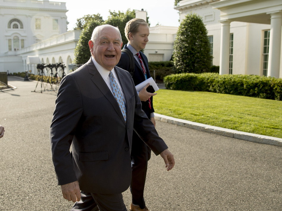 Agriculture Secretary Sonny Perdue announced on Thursday $16 billion in aid to help farmers hurt by the ongoing U.S.-China trade dispute. (Andrew Harnik/AP)