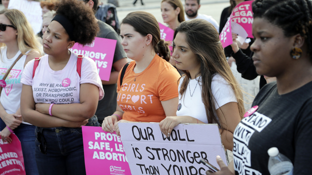 Demonstrators listen to speeches during a rally in support of abortion rights on Thursday in Miami. (Lynne Sladky/AP)