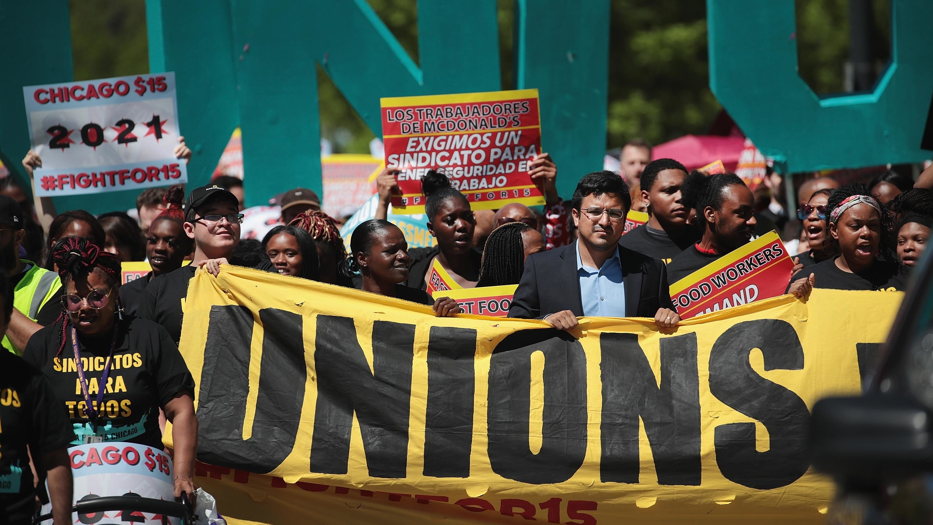 Demonstrators march to McDonald's corporate headquarters in Chicago on Thursday to demand $15-per-hour wages for fast food workers.