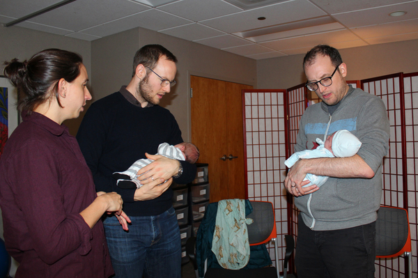 Alex Gourse (right), chats with Frances Miller and Chris Henderson as they hold their brand-new babies during the final session of a CenteringPregnancy group at Northwestern Medicine.