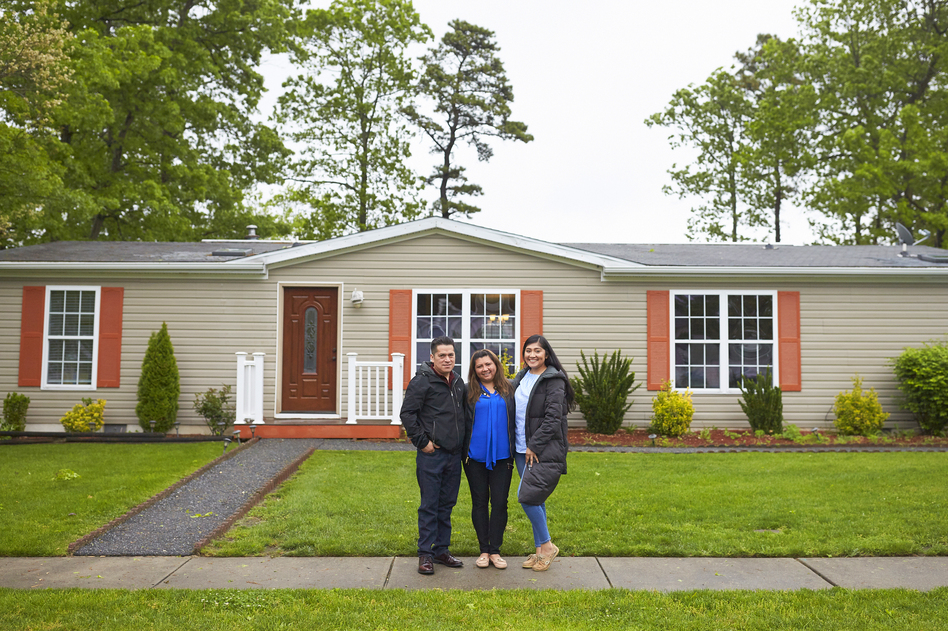 """The Martinez family stands in front of their home in New Jersey. During a speech at her graduation, Alondra said to her parents: """"Mamá, papá, lo logramos."""" Mom, dad, we made it. (Mohamed Sadek for NPR)"""