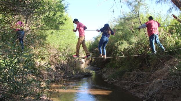 U.S. citizens use ropes to cross the Rio Grande from San Antonio del Bravo, Mexico, into Candelaria, Texas. U.S. citizens depend on the free health clinic in San Antonio del Bravo. (Lorne Matalon for NPR)