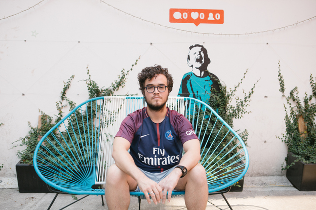 Claudio Gage poses for a portrait at the Hola Code offices in Mexico City on May 13. Gage was deported to Mexico after having lived in the U.S. for more than a decade. (Alicia Vera for NPR)