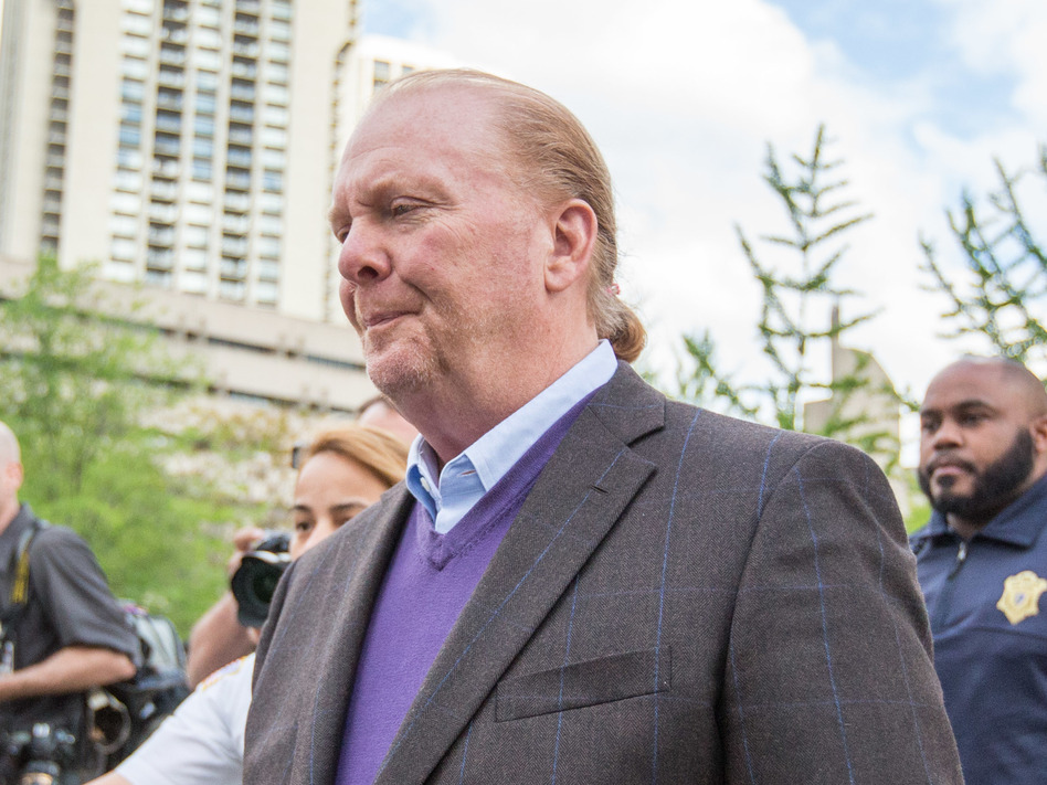 Celebrity chef Mario Batali leaves Boston Municipal Court on Friday following a court appearance on a charge of indecent assault and battery in connection with a 2017 incident at a restaurant of his in Boston. (Scott Eisen/Getty Images)