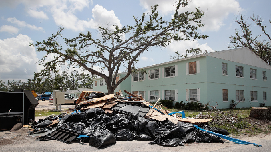 Debris is piled on May 10 outside an apartment complex that was damaged by Hurricane Michael in Panama City, Fla. Rep. Chip Roy objected to a procedural vote on a bipartisan $19.1 billion disaster aid bill, forcing Congress to wait until June to finish work on the legislation. (Scott Olson/Getty Images)