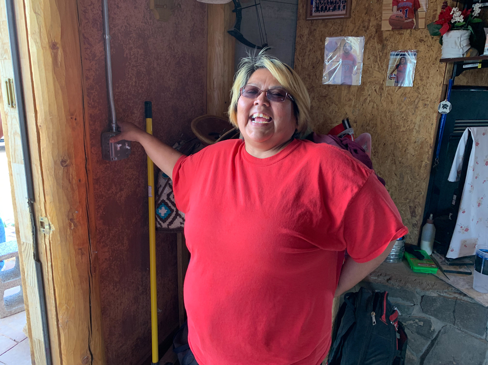 Neda Billie says she's so excited to turn the lights on in her home on the Navajo Nation. About 10% of Navajos on the reservation live without electricity, and as much as 40% have to haul their water and use outhouses. (Laurel Morales/KJZZ)